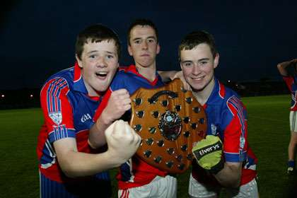 North Meath Gaels joint captains Padraig Carolan,Conor O'Halloran and Jonathon Byrne show off the spoils of victory at Pairc Tailteann.